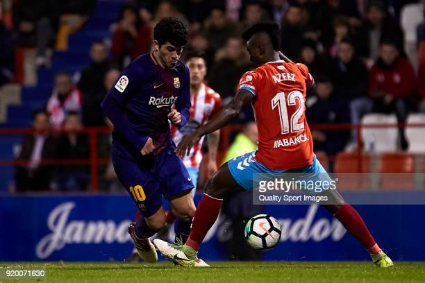 Carles Alena of FC Barcelona B is challenged by Ramon Azeez of CD Lugo during the La Liga 123 match between CD Lugo and FC Barcelona B at Angel Carro...