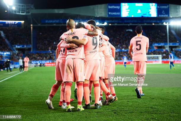 Carles Alena of FC Barcelona celebrates after scoring with his team mates during the La Liga match between Deportivo Alaves and FC Barcelona at...