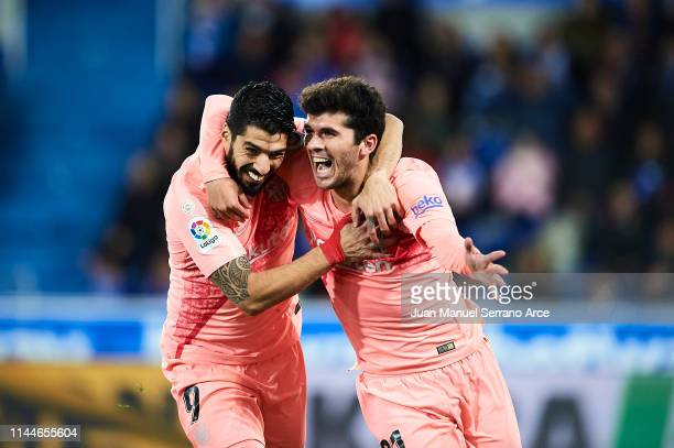 Carles Alena of FC Barcelona celebrates after scoring with Luis Suarezof FC Barcelona during the La Liga match between Deportivo Alaves and FC...