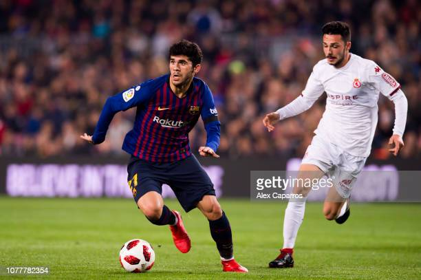 Carles Alena of FC Barcelona eludes the pressure from Jesus Bernal of Cultural Leonesa during the Copa del Rey fourth round second leg match between...
