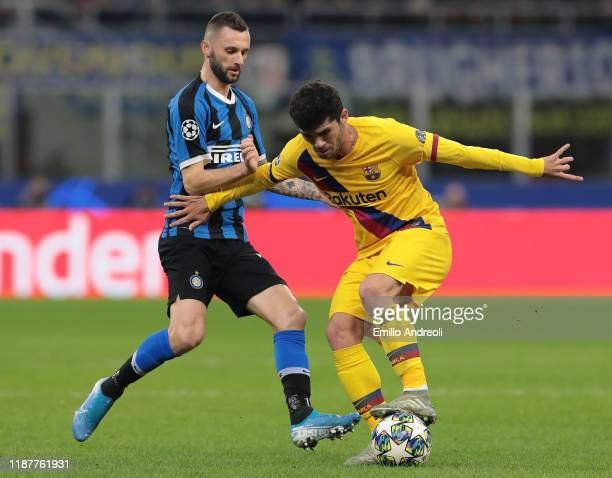 Carles Alena of FC Barcelona is challenged by Marcelo Brozovic of FC Internazionale during the UEFA Champions League group F match between FC...