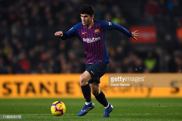 Carles Alena of FC Barcelona runs with the ball during the La Liga match between FC Barcelona and Real Valladolid CF at Camp Nou on February 16 2019...