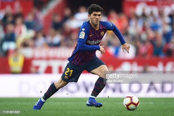 Carles Alena of FC Barcelona runs with the ball during the La Liga match between Sevilla FC and FC Barcelona at Estadio Ramon Sanchez Pizjuan on...