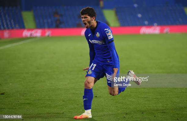 Carles Alena of Getafe CF celebrates after scoring their side's third goal during the La Liga Santander match between Getafe CF and Valencia CF at...