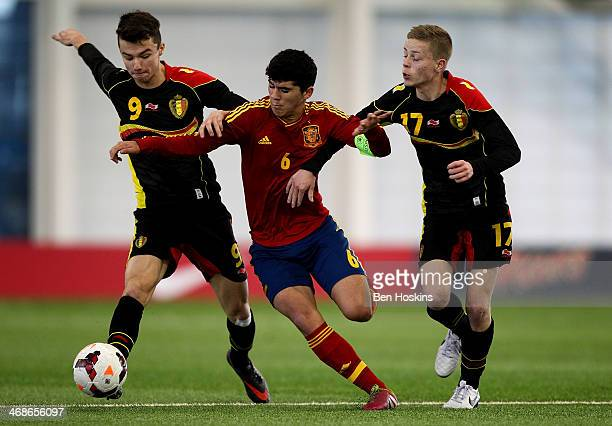 Carles Alena of Spain holds off the challenges of Dennis Van Vaerenbergh and Dante Rigo of Belgium during a U16 International match between Spain and...