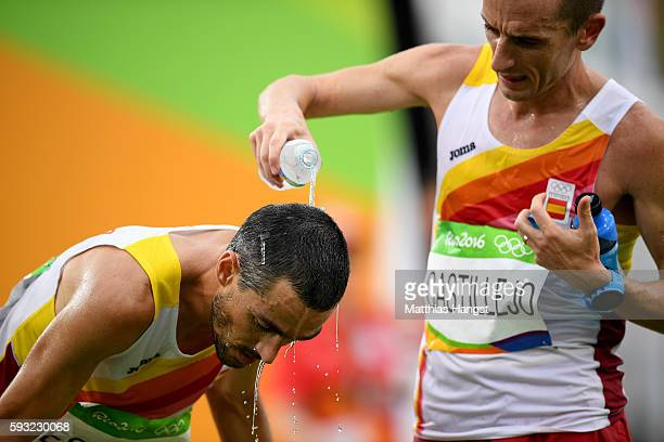 Carles Castillejo of Spain cools down Jesus Espanya of Spain after the Men's Marathon on Day 16 of the Rio 2016 Olympic Games at Sambodromo on August...