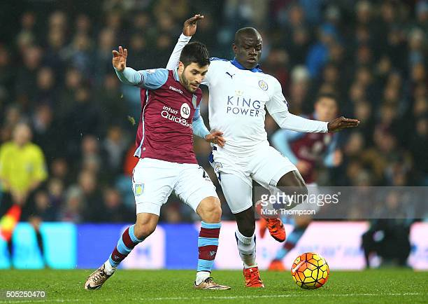Carles Gil of Aston Villa and Ngolo Kante of Leicester City compete for the ball during the Barclays Premier League match between Aston Villa and...