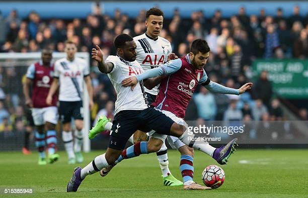 Carles Gil of Aston Villa battles with Danny Rose of Tottenham Hotspur during the Barclays Premier League match between Aston Villa and Tottenham...