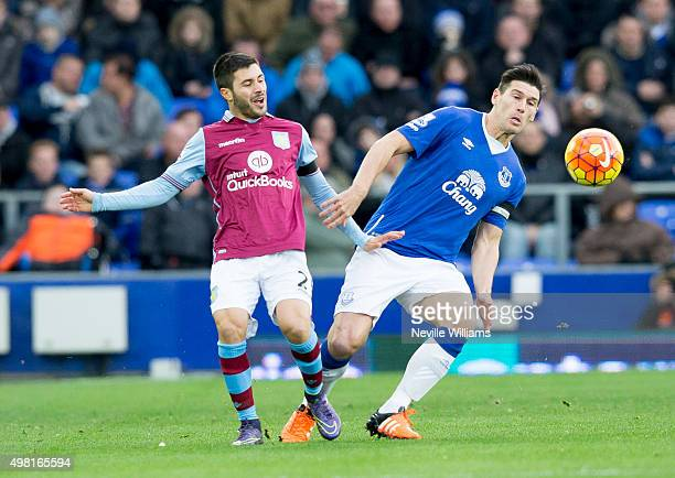 Carles Gil of Aston Villa is challenged by Gareth Barry of Everton during the Barclays Premier League match between Everton and Aston Villa at...