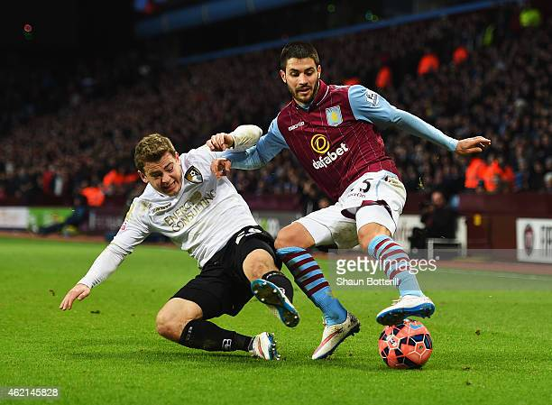 Carles Gil of Aston Villa is tackled by Ryan Fraser of Bournemouth during the FA Cup Fourth Round match between Aston Villa and AFC Bournemouth at...