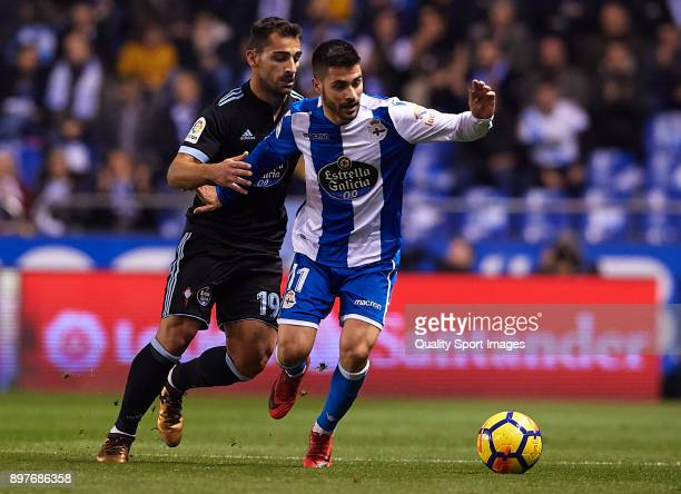 Carles Gil of Deportivo de La Coruna competes for the ball with Jonathan Castro of Celta de Vigo during the La Liga match between Deportivo de La...