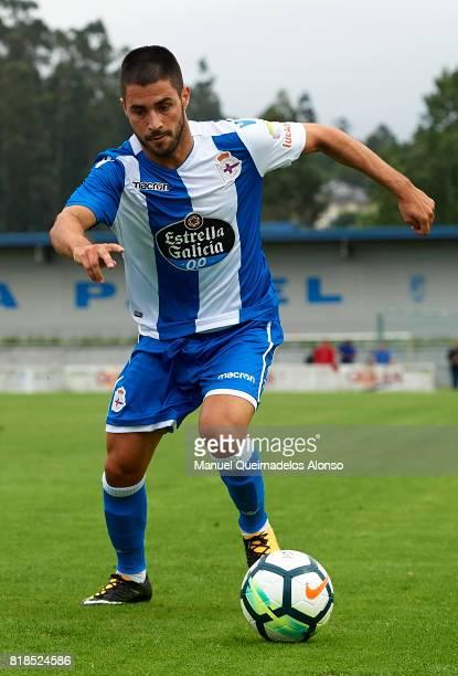 Carles Gil of Deportivo de La Coruna runs with the ball during the preseason friendly match between Cerceda and Deportivo de La Coruna at O Roxo...