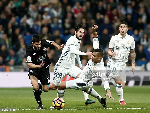 Carles Gil of Deportivo La Coruna in action against Carlos Casemiro of Real Madrid CF during the La Liga match between Real Madrid CF and RC...