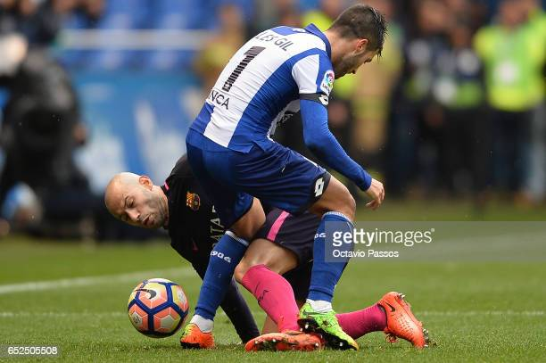 Carles Gil of RC Deportivo La Coruna competes for the ball with Javier Mascherano of FC Barcelona during the La Liga match between RC Deportivo La...