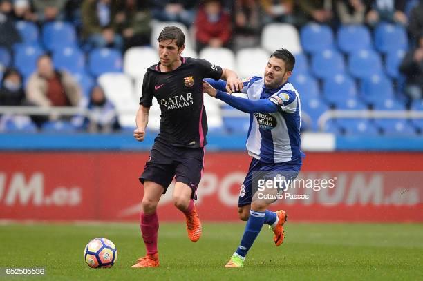 Carles Gil of RC Deportivo La Coruna competes for the ball with Sergi Roberto of FC Barcelona during the La Liga match between RC Deportivo La Coruna...