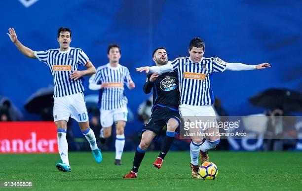 Carles Gil of RC Deportivo La Coruna duels for the ball with Igor Zubeldia of Real Sociedad during the La Liga match between Real Sociedad de Futbol...