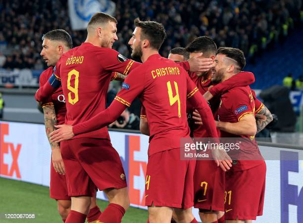 Carles Perez of AS Roma celebrates after scoring his goal with his team mates during the UEFA Europa League round of 32 first leg match between AS...