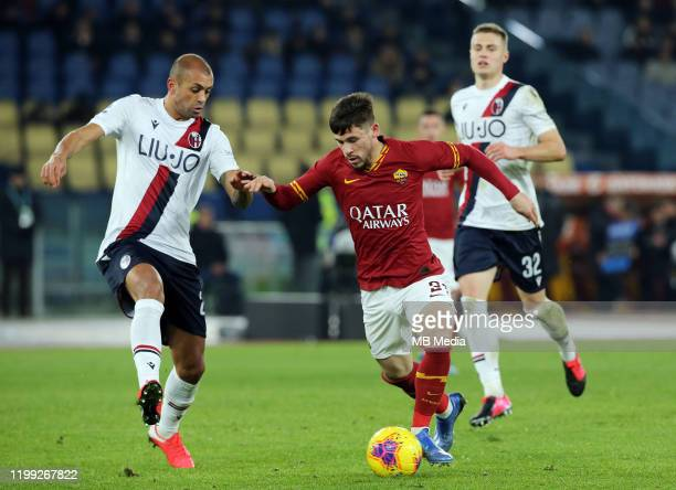 Carles Perez of AS Roma competes for the ball with Danilo of Bologna FC during the Serie A match between AS Roma and Bologna FC at Stadio Olimpico on...