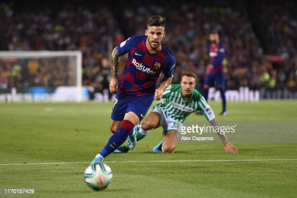 Carles Perez of Barcelona runs with the ball during the Liga match between FC Barcelona and Real Betis at Camp Nou on August 25 2019 in Barcelona...