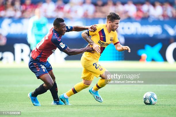 Carles Perez of FC Barcelona being followed by Pervis Estupinan of CA Osasuna during the Liga match between CA Osasuna and FC Barcelona at Estadio El...