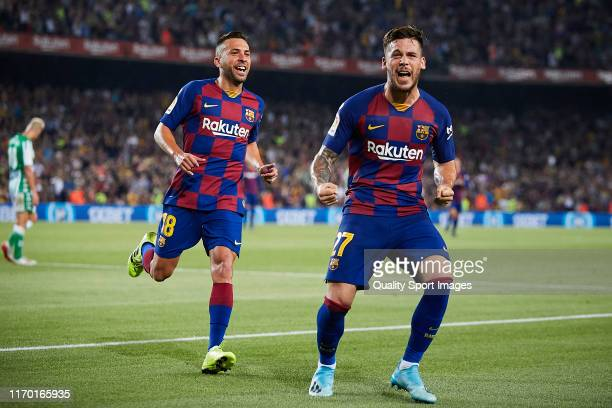 Carles Perez of FC Barcelona celebrates scoring his team's third goal with team mates during the Liga match between FC Barcelona and Real Betis...
