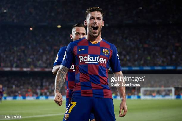 Carles Perez of FC Barcelona celebrates scoring his team's third goal with Jordi Alba during the Liga match between FC Barcelona and Real Betis...