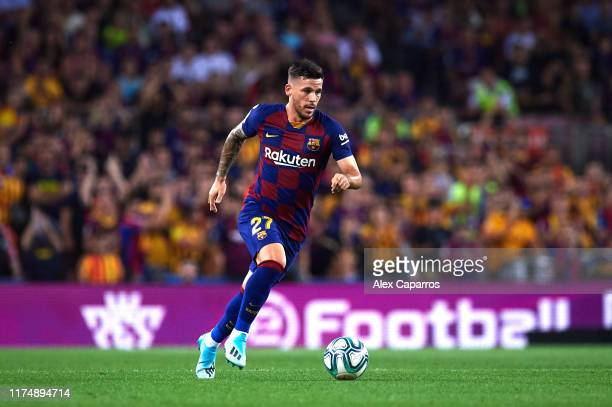 Carles Perez of FC Barcelona runs with the ball during the La Liga match between FC Barcelona and Valencia CF at Camp Nou on September 14 2019 in...