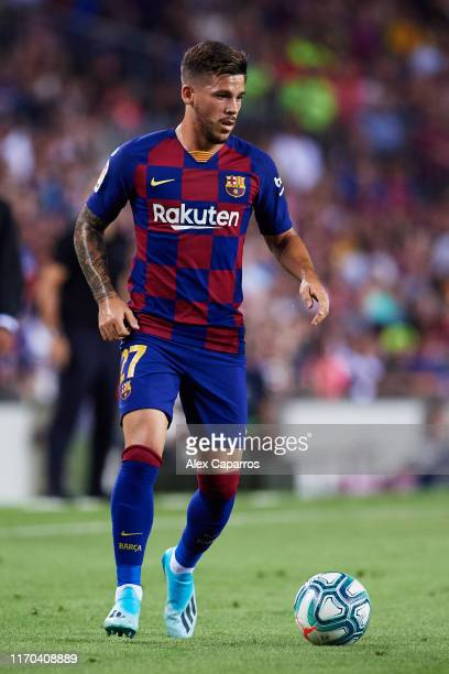 Carles Perez of FC Barcelona runs with the ball during the Liga match between FC Barcelona and Real Betis Balompie at Camp Nou on August 25 2019 in...