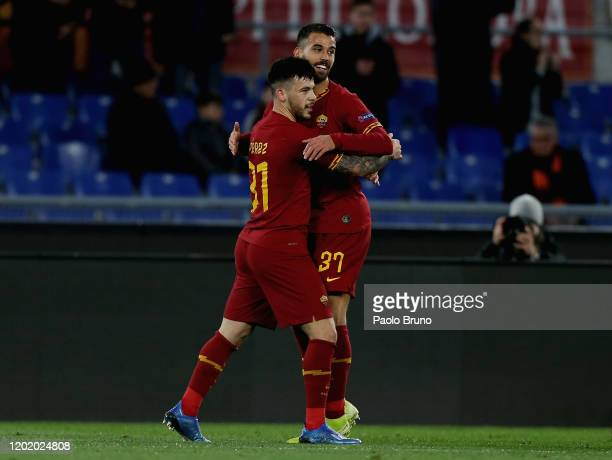 Carles Perez with his teammate Leonardo Spinazzola of AS Roma celebrates after scoring the opening goal during the UEFA Europa League round of 32...