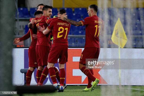 Carles Perez with his teammates of AS Roma celebrates after scoring the opening goal during the UEFA Europa League round of 32 first leg match...