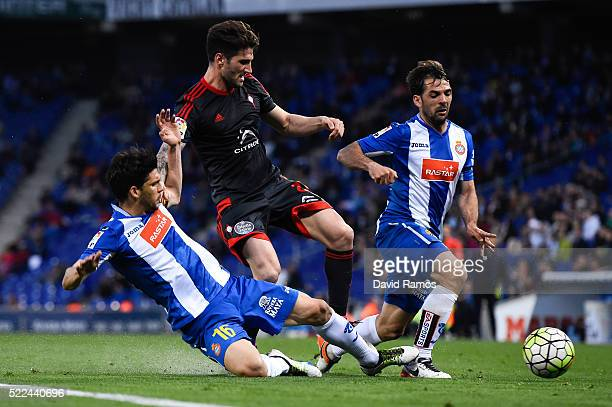 Carles Planas of RC Celta de Vigo competes for the ball with Javi Lopez and Victor Sanchez of RCD Espanyol during the La Liga match between Real CD...