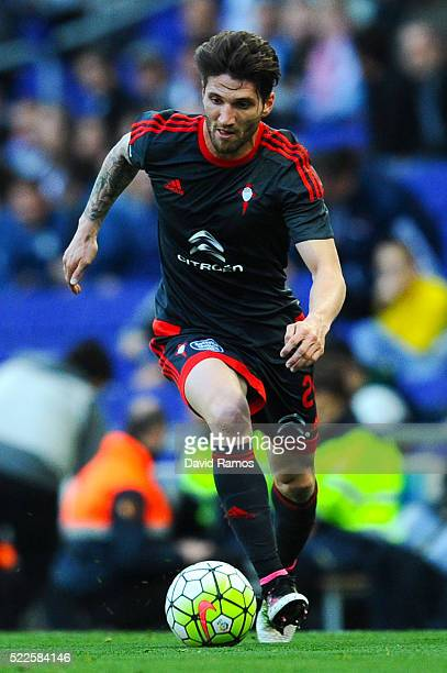 Carles Planas of RC Celta de Vigo runs with the ball during the La Liga match between Real CD Espanyol and Celta Vigo at CornellaEl Prat Stadium on...