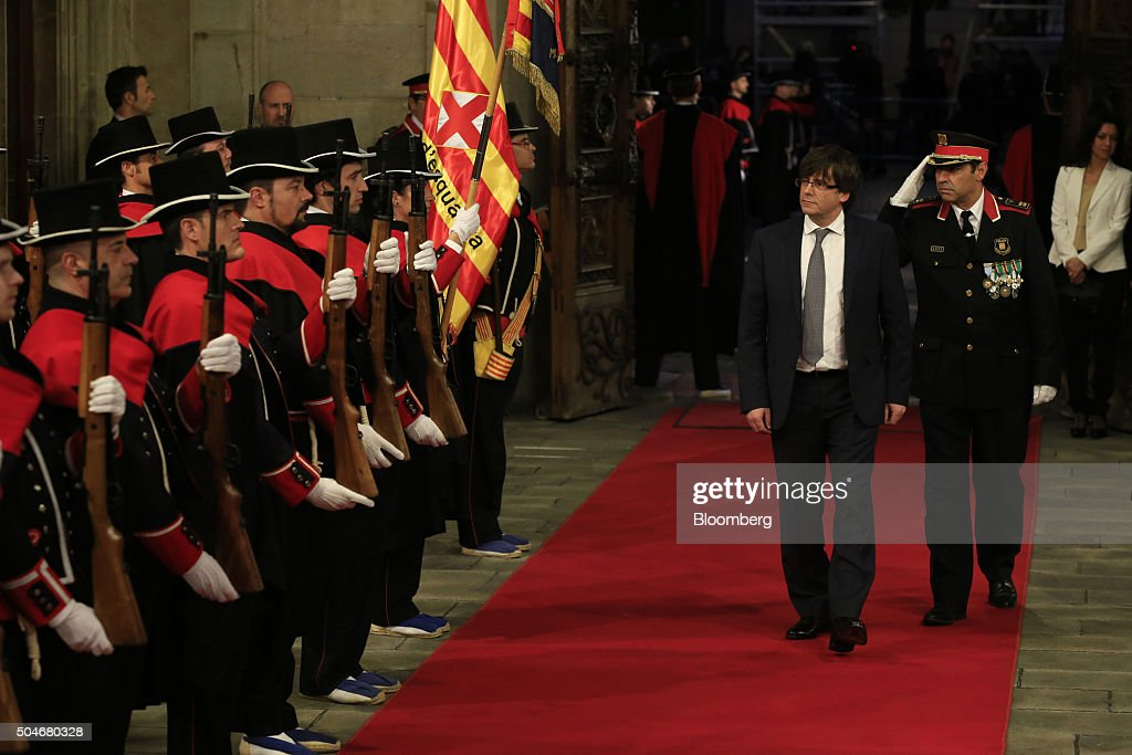 Carles Puigdemont, Catalonia's incoming president, second right, arrives to be sworn into office at the Palau de la Generalitat in Barcelona, Spain, on Tuesday, Jan. 12, 2016. The former mayor of Girona, a city near Spain's border with France, emerged as a last-minute compromise candidate as the fighting between two factions within the independence movement threatened to force new elections, jeopardizing their majority in the regional assembly. Photographer: Pau Barrena/Bloomberg via Getty Images