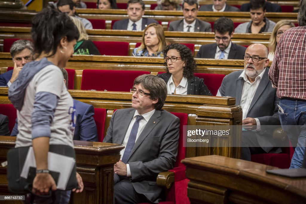 Carles Puigdemont, Catalonia's president, front left, sits during a parliament session in Barcelona, Spain, on Thursday, Oct. 26, 2017. Puigdemont says he won't call a regional election that could have defused tension with Spain. Photographer: Angel Garcia/Bloomberg via Getty Images