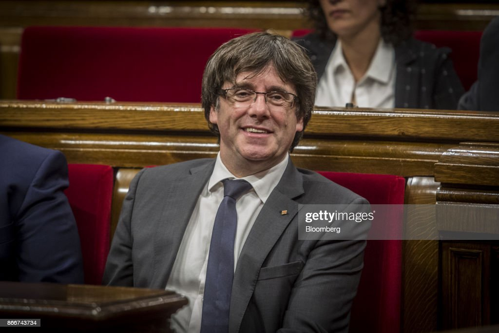 Carles Puigdemont, Catalonia's president, smiles during a parliament session in Barcelona, Spain, on Thursday, Oct. 26, 2017. Puigdemont says he won't call a regional election that could have defused tension with Spain. Photographer: Angel Garcia/Bloomberg via Getty Images