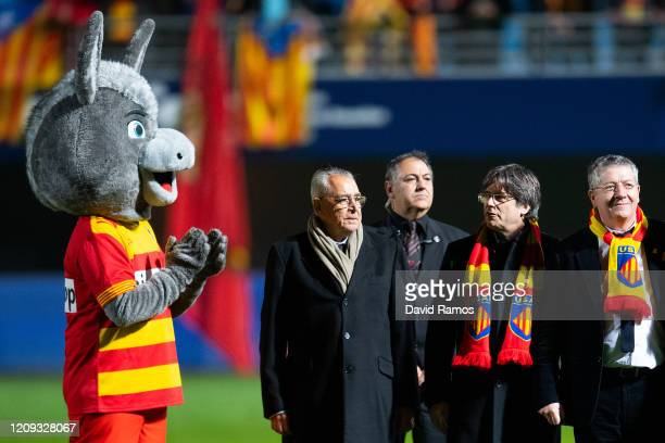 Carles Puigdemont, former President of Catalonia, walks onto the pitch next to the USAP Perpignan mascot after the Pro D2 match between USAP...