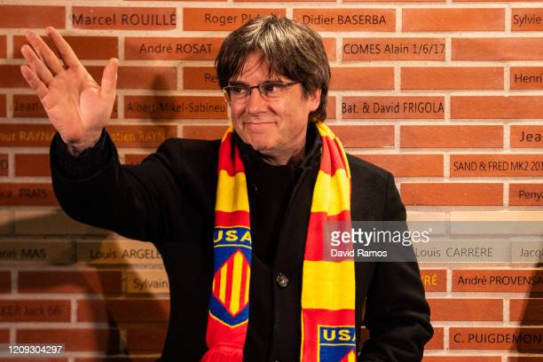 Carles Puigdemont, former President of Catalonia, waves to his supporters after unveiling a brick with his name in the USAP Legends Wall prior to the...