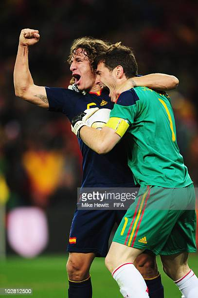 Carles Puyol and Iker Casillas of Spain celebrate winning the World Cup after the 2010 FIFA World Cup South Africa Final match between Netherlands...