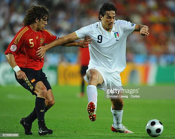 carles Puyol and Luca Toni during the UEFA EURO 2008 quarter final match between Spain and Italy at the Ernst Happel stadium in Vienna Austria