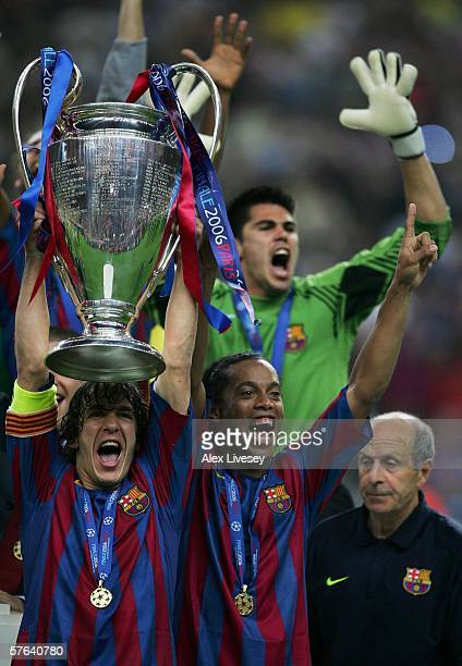 Carles Puyol and Ronaldinho of Barcelona lift the trophy with celebrating team mates after they win the UEFA Champions League Final between Arsenal...