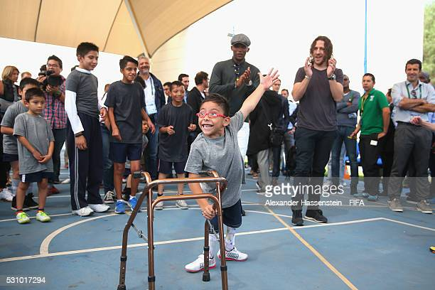Carles Puyol and Samuel Etoo plays football with the kids as they and the FIFA Legends visit the Teleton foundation rehabilitation center at CRIT...