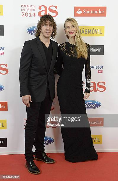 Carles Puyol and Vanesa Lorenzo attend the 2014 AS Sports Awards at The Westin Palace Hotel on December 15 2014 in Madrid Spain