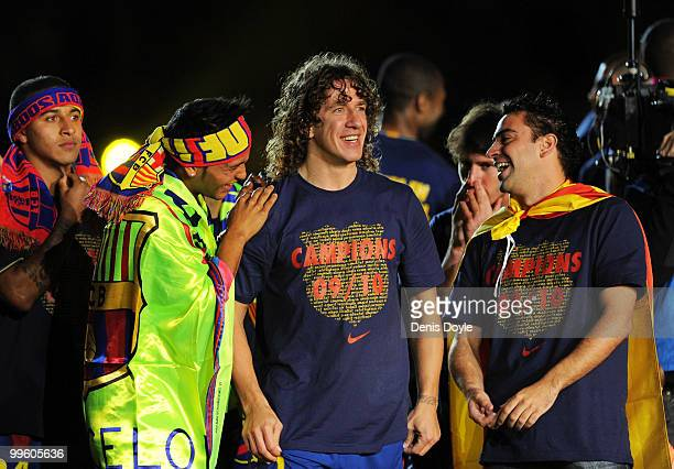 Carles Puyol and Xavi Hernandez of Barcelona celebrate after Barcelona beat Real Valladolid 40 to clinch La Liga title after their match at Camp Nou...