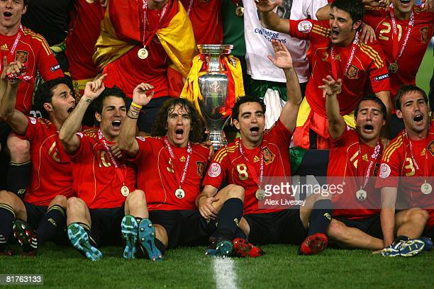 Carles Puyol and Xavi Hernandez of Spain celebrate with team mates after the UEFA EURO 2008 Final match between Germany and Spain at Ernst Happel...