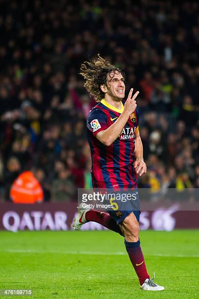Carles Puyol celebrates after scoring his team's third goal during the La Liga match between FC Barcelona and UD Almeria at Camp Nou on March 2, 2014...