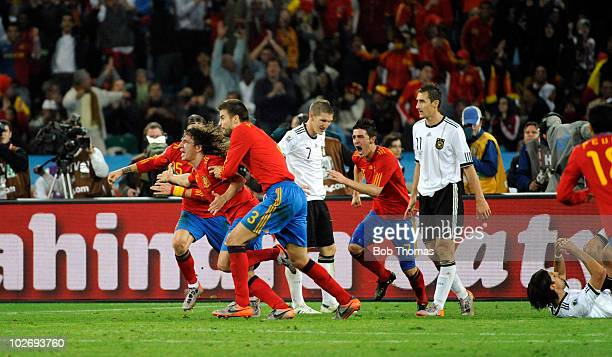 Carles Puyol celebrates with team-mates, including Gerard Pique, after scoring Spain's goal during the 2010 FIFA World Cup South Africa Semi Final...