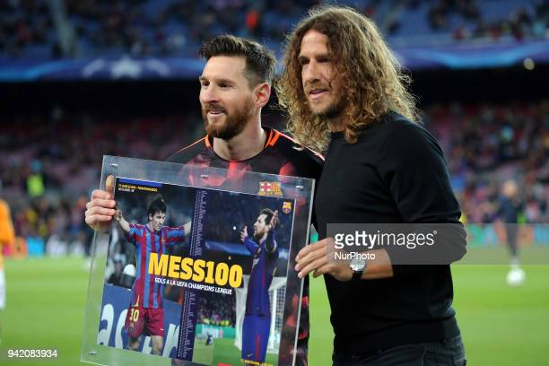 Carles Puyol delivers a souvenir to Leo Messi after scoring 100 goals in the Champions League before the match between FC Barcelona and AS Roma for...