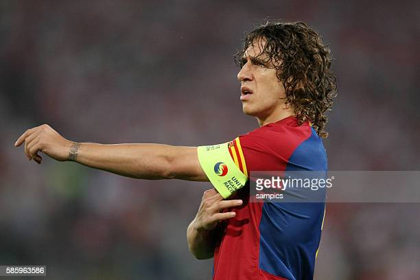 Carles Puyol of Barcelona adjusts his captains armband