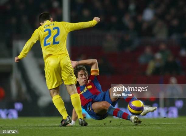 Carles Puyol of Barcelona and Giuseppe Rossi of Villarreal are shown in action during the Copa del Rey's match between FC Barelona and Villarreal at...
