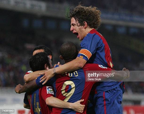 Carles Puyol of Barcelona celebrates after Andres Inesta scored Barcelona's first goal during the Primera Liga match between Real Sociedad and...